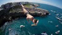 Cliff diver competes in Italy