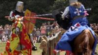 Tom getting medieval on another knight