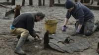 Bronze Age wheel being examined by archaeologists