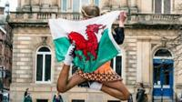 Ffion dancing in Glasgow with the Welsh flag