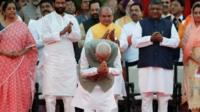 At a ceremony in Delhi, Narendra Modi is sworn in for a second term as India's prime minister.