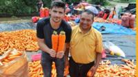 Ben Zand and two giant carrots