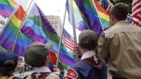 Cub Scouts and Boy Scouts prepare to lead marchers while waving flags at the 41st annual Pride Parade Sunday, June 28, 2015, in Seattle