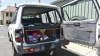 The vehicle driven by the backpacker