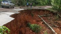 Road shown with damage inflicted by Cyclone Idai