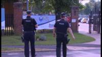Police officers outside RAF Marham