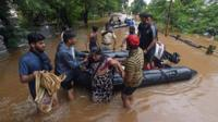 Woman rescued from flooding