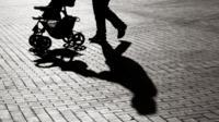 Parent pushing pram