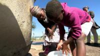 Young boy washing his hands