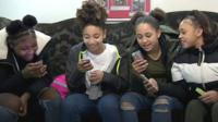 Girls playing with their phones