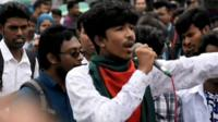 Protester speaking to crowds in Bangladesh