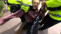 The arrest came as the prime minister arrived at a election campaign event in Wrexham.