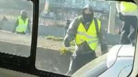Yellow-vest protester filmed from a police van