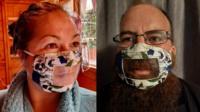 People wearing transparent masks