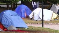 Migrant tents near Lake Como