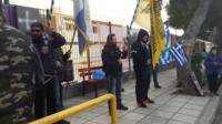 Protesters outside a school in Greece