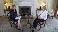 Laura Kuenssberg (left) and Theresa May