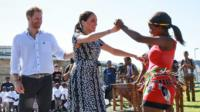 Harry and Meghan dance after arriving in Africa