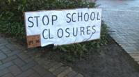 """""""Stop school closures"""" sign"""