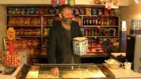 Michael Sheen serving popcorn