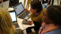 Women around a computer