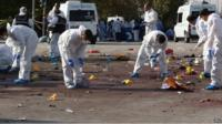 Forensic teams of the police investigate the area after multiple explosions ahead of a rally in Ankara, Turkey
