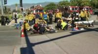 Emergency services deal with injured on the street