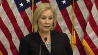 Senator Gillibrand speaks at podium