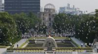 In this August 6, 2013 file photo, doves fly over the cenotaph dedicated to the victims of the atomic bombing at the Hiroshima Peace Memorial Park during a ceremony marking the 68th anniversary of the bombing, in Hiroshima, western Japan.