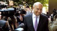 Keith Vaz surrounded by photographers