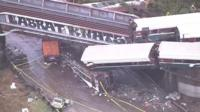 Carriages plummeted off both sides of a highway bridge in Washington state after a train derailed.