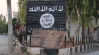 Makeshift sign belonging to so-called Islamic State in Syrian town of Jarablus