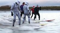 Star Wars stormtroppers riding the Severn Bore