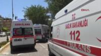 Ambulances arrive at the scene in Suruc