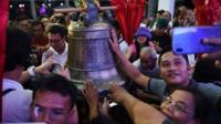 Crowds reach to touch the Balangiga bell