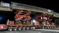 Centre section of bridge being removed