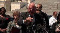 Bernie Sanders speaks at podium