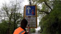 Cleaning a road sign