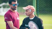 Blind tennis player and coach