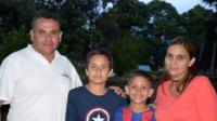 Andrew Paez and his wife and their two sons