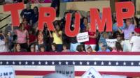 Supporters of Republican presidential candidate Donald Trump waving signs prior to the start of a rally in Roanoke, on 24 September 2016.