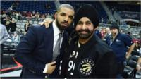 Drake and Nav Bhatia ata Toronto Raptor game.