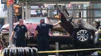 Car rests on its side following Times Square crash
