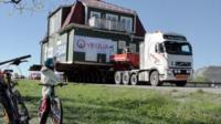 A house being transported by lorry in Kiruna