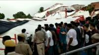 Crowds search for survivors at the scene of the disaster in Rajasthan