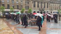 People in Dundee observe the minute's silence
