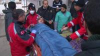 Wounded woman on a stretcher