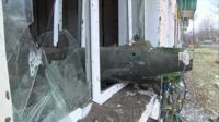 Снаряд в окне жилого дома