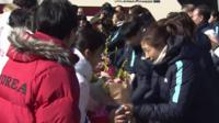 The North Korean women's ice hockey team has arrived in South Korea to form a joint Olympic team.