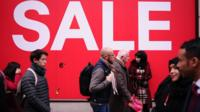 Sales shoppers pack Oxford Street in London, England, on December 28, 2018